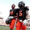 Photo - Oklahoma State's Justin Horton (14) and Josh Stewart (5) warm up before the college football game between the Oklahoma State University Cowboys (OSU) and the University of Kansas Jayhawks (KU) at Boone Pickens Stadium in Stillwater, Okla., Saturday, Oct. 8, 2011 Photo by Steve Sisney, The Oklahoman