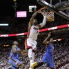 Miami\'s Dwyane Wade (3) dunks the ball between Oklahoma City\'s Serge Ibaka (9) and Kevin Durant (35) during Game 3 of the NBA Finals between the Oklahoma City Thunder and the Miami Heat at American Airlines Arena, Sunday, June 17, 2012. Oklahoma City lost 91-85. Photo by Bryan Terry, The Oklahoman