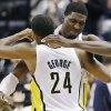 Indiana Pacers\' Paul George (24) embraces Roy Hibbert after defeating the New Orleans Hornets 115-107 in overtime of an NBA basketball game, Wednesday, Nov. 21, 2012, in Indianapolis. (AP Photo/Darron Cummings)