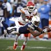 Photo - San Diego Chargers wide receiver Eddie Royal, front, can't hold on to a pass as Kansas City Chiefs defensive back Ron Parker defends during the second half in an NFL football game, Sunday, Dec. 29, 2013, in San Diego. (AP Photo/Lenny Ignelzi)