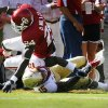 Demarco Murray (24) is tackled by Ochuko Jenije (15) during the first half of the college football game between the University of Oklahoma Sooners (OU) and Florida State University Seminoles (FSU) at the Gaylord Family-Oklahoma Memorial Stadium on Saturday, Sept. 11 2010, in Norman, Okla. Photo by Steve Sisney, The Oklahoman