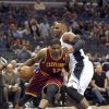 Photo - Orlando Magic forward Glen Davis (11) blocks the path of Cleveland Cavaliers forward Tristan Thompson (13) during the first half of an NBA basketball game on Friday, Dec. 13, 2013, in Orlando, Fla. (AP Photo/Reinhold Matay)