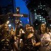 Photo - Striking teachers hold up crosses during a march on the nation's teacher recognition day, in Rio de Janeiro, Brazil, Tuesday, Oct. 15, 2013. Teachers have been on strike demanding better pay for over two months. (AP Photo/Felipe Dana)