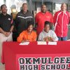 Okmulgee High School senior Brittany Stallings, front row left, signed a National Letter of Intent with Oklahoma State University on Wednesday afternoon. Stallings will participate in track and field for the Stillwater college. Seated next to Stallings is her mother, Marva Stallings. Also present for the signing were, back row, L to R: Okmulgee Athletic Director Kevin Gordon, Okmulgee girls track coach Gary Robbins, Okmulgee assistant track coach Kevin Rucker, and Okmulgee head track coach Dwight Pankey. (Photo by Patrick Ford, Okmulgee Times)