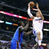 The Los Angeles Clippers\' Blake Griffin, right, makes a basket over the Oklahoma City Thunder\'s Serge Ibaka at Staples Center in Los Angeles, California, on Tuesday, January 22, 2013. (Wally Skalij/Los Angeles Times/MCT) ORG XMIT: 1134003