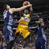 Denver Nuggets forward Kenneth Faried, center, goes up for a shot between Charlotte Bobcats center Byron Mullens, left, and Bismack Biyombo, of the Republic of Congo, in the third quarter of the Nuggets\' 110-88 victory in an NBA basketball game in Denver, Saturday, Dec. 22, 2012. (AP Photo/David Zalubowski)