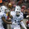 Photo - Tulane cornerback Derrick Strozier (13) celebrates his interception against Louisiana-Lafayette during the second half of the New Orleans Bowl NCAA college football game in New Orleans, Saturday, Dec. 21, 2013.  (AP Photo/Bill Haber)