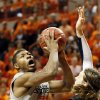 Oklahoma State\'s Marcus Smart (33) attacks the basket as Gonzaga\'s Kelly Olynyk (13) defends during a men\'s college basketball game between Oklahoma State University (OSU) and Gonzaga at Gallagher-Iba Arena in Stillwater, Okla., Monday, Dec. 31, 2012. Gonzaga won, 69-68. Photo by Nate Billings, The Oklahoman