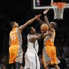 Brooklyn Nets\' Andray Blatche (0) shoots between Phoenix Suns\' Markieff Morris (11) and Jermaine O\'Neal (20) in the second half of an NBA basketball game on Friday, Jan., 11, 2013 at Barclays Center in New York. The Nets won 99-79. (AP Photo/Kathy Kmonicek)