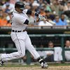 Detroit Tigers\' Victor Martinez hits a one-run double against the Seattle Mariners in the seventh inning of a baseball game in Detroit, Thursday, Sept. 19, 2013. (AP Photo/Paul Sancya)