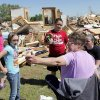 Debbie Whisennand, right, talks with, from left, Madison Diercks, 10, Alyssa Sutton, 9, Kirstyn Hines, 11, and Rachael Diercks, 13, while they take a break from going through what is left of Whisennand\'s home in Woodward, Okla., Monday, April 16, 2012. Madison Diercks and Rachael Diercks used to attend the day care Whisennand ran out of her house. A tornado struck Woodward early Sunday morning. Photo by Nate Billings, The Oklahoman