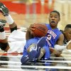 Milloowd\'s Cameron Batson and Hugo\'s Nick Brown fight for the ball during a Class 3A boys state basketball tournament game between Hugo and Millwood at Yukon High School in Yukon, Okla., Thursday, March 7, 2013. Photo by Bryan Terry, The Oklahoman