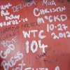 This Jan. 15, 2013 photo shows graffiti left by workers on a steel column on the 104th floor of One World Trade Center in New York. Construction workers finishing New York\'s tallest building at the World Trade Center are leaving their personal marks on the concrete and steel in the form of graffiti. (AP Photo/Mark Lennihan)