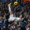 Photo - Real Madrid's Cristiano Ronaldo from Portugal, top, tries to score in between opposition players during a Spanish La Liga soccer match between Real Madrid and Granada at the Santiago Bernabeu stadium in Madrid, Spain, Saturday, Jan. 25, 2014. (AP Photo/Andres Kudacki)
