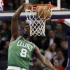 Boston Celtics\' Jeff Green (8) dunks over Charlotte Bobcats\' Jeff Adrien (4) during the first half of an NBA basketball game in Charlotte, N.C., Monday, Feb. 11, 2013. (AP Photo/Chuck Burton)