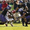 TCU\'s Elisha Olabode (6) and Jason Verrett (2) bring down Oklahoma\'s Jalen Saunders (18) after a catch during the second half of the college football game where the University of Oklahoma Sooners (OU) defeated the Texas Christian University Horned Frogs (TCU) 24-17 at Amon G. Carter Stadium in Fort Worth, Texas, on Saturday, Dec. 1, 2012. Photo by Steve Sisney, The Oklahoman