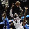 Atlanta Hawks forward Josh Smith (5) splits the defense of Orlando Magic forward Maurice Harkless, left, and power forward Kyle O\'Quinn during the first half of an NBA basketball game on Saturday, March 30, 2013, in Atlanta. (AP Photo/John Amis)