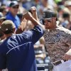 San Diego Padres\' Brooks Conrad is greeted at the dugout after his solo home run against the San Francisco Giants in the seventh inning of a baseball game Sunday, July 6, 2014, in San Diego. (AP Photo/Lenny Ignelzi)