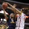West Virginia\' Averee Fields (5) has her shot attempt blocked by Oklahoma\'s Nicole Griffin (4) in the first half of an NCAA college basketball game in the Big 12 women\'s tournament Saturday, March 9, 2013, in Dallas. (AP Photo/Tony Gutierrez)