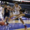 Oklahoma\'s Nicole Griffin (4) goes for the ball between West Virginia\'s Averee Fields (5) and Crystal Leary (32) during the Big 12 tournament women\'s college basketball game between the University of Oklahoma and West Virginia at American Airlines Arena in Dallas, Saturday, March 9, 2012. Oklahoma won 65-64. Photo by Bryan Terry, The Oklahoman