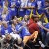 Miami\'s Dwyane Wade (3) falls into the crowd during Game 1 of the NBA Finals between the Oklahoma City Thunder and the Miami Heat at Chesapeake Energy Arena in Oklahoma City, Tuesday, June 12, 2012. Photo by Sarah Phipps, The Oklahoman