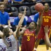 Photo - Iowa State forward Melvin Ejim, right, shots over Boise State's Anthony Drmic (3) during the first half of an NCAA college basketball game at the Diamond Head Classic on Wednesday, Dec. 25, 2013, in Honolulu. (AP Photo/Eugene Tanner)