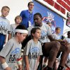 Kevin Durant pulls Hunter Newman, 6, and jack Barbar, 7, a little closer for a team photograph during Durant\'s basketball camp on Thursday, Aug. 7, 2014 in Moore, Okla. Photo by Steve Sisney, The Oklahoman