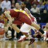 Iowa State guard Chris Babb, front, beats Oklahoma guard Steven Pledger to a loose ball during the first half an NCAA college basketball game in the Big 12 Conference tournament Thursday, March 14, 2013, in Kansas City, Mo. (AP Photo/Charlie Riedel) ORG XMIT: MOCR102