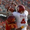 Oklahoma\'s Kenny Stills (4) catches a touchdown pass beside Iowa State\'s Jeremy Reeves (5) during a college football game between the University of Oklahoma (OU) and Iowa State University (ISU) at Jack Trice Stadium in Ames, Iowa, Saturday, Nov. 3, 2012. Photo by Bryan Terry, The Oklahoman