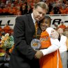 OSU coach Kurt Budke hugs Andrea Riley during senior night before the NCAA women\'s college basketball game between Oklahoma State University and Iowa State at Gallagher-Iba Arena in Stillwater, Okla., Wednesday, March 3, 2010. Photo by Bryan Terry, The Oklahoman