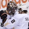 Photo - Anaheim Ducks Teemu Selanne (8) speaks with Anaheim Ducks goalie John Gibson (36) following their 3-0 win over the Vancouver Canucks in Vancouver, Monday, April 7, 2014. (AP Photo/The Canadian Press, Jonathan Hayward)