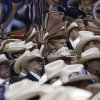 Texas delegates fashion cowboy hats in their section as they are reflected on the mirror-sided the camera stand during the Republican National Convention in Tampa, Fla., on Thursday, Aug. 30, 2012. (AP Photo/Patrick Semansky) ORG XMIT: RNC751