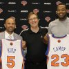 Photo -   Jason Kidd, left, and Marcus Camby, right, pose with their new jerseys and New York Knicks general manager Glen Grunwald after the team announced their newest signees at the team's NBA basketball training facility in Tarrytown, N.Y., Thursday, July 12, 2012. (AP Photo/Kathy Willens)