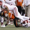 Oklahoma\'s R.J. Washington (91) brings down Oklahoma State\'s Joseph Randle (1) during the Bedlam college football game between the Oklahoma State University Cowboys (OSU) and the University of Oklahoma Sooners (OU) at Boone Pickens Stadium in Stillwater, Okla., Saturday, Dec. 3, 2011. Photo by Chris Landsberger, The Oklahoman