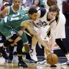 Photo - Utah Jazz's Gordon Hayward, right, and Boston Celtics' Courtney Lee (11) chase a loose ball in the second quarter during an NBA basketball game, Monday, Feb. 25, 2013, in Salt Lake City. (AP Photo/Rick Bowmer)