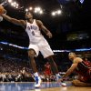 Oklahoma City\'s Serge Ibaka (9) saves a ball from going outbounds as Miami Heat\'s Shane Battier looks on during the NBA basketball game between the Miami Heat and the Oklahoma City Thunder at Chesapeake Energy Arena in Oklahoma City, Sunday, March 25, 2012. Photo by Sarah Phipps The Oklahoman