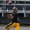 Photo - Iowa senior wide receiver Kevonte Martin-Manley pulls in a pass during their spring NCAA college football game Saturday, April 12, 2014, at Valley High Stadium in Wesst Des Moines, Iowa. (AP Photo/The Des Moines Register, Bryon Houlgrave)  MAGS OUT, TV OUT, NO SALES, MANDATORY CREDIT