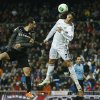 Real Madrid\'s Cristiano Ronaldol, right, in action with Espanyol\'s Sergio Garcia, left, during a Copa del Rey soccer match between Real Madrid and Espanyol at the Santiago Bernabeu stadium in Madrid, Spain, Tuesday, Jan. 28, 2014. (AP Photo/Andres Kudacki)