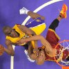 Photo - Los Angeles Lakers guard Jodie Meeks, left, puts up a shot as Cleveland Cavaliers guard Jarrett Jack defends during the first half of an NBA basketball game, Tuesday, Jan. 14, 2014, in Los Angeles. (AP Photo/Mark J. Terrill)