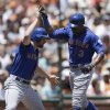 Photo - New York Mets' Curtis Granderson, right, celebrates with Daniel Murphy after Granderson hit a two run home run off San Francisco Giants' Tim Lincecum in the first inning of a baseball game Sunday, June 8, 2014, in San Francisco. (AP Photo/Ben Margot)