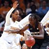 Photo - South Carolina forward Aleighsa Welch (24) drives against Tennessee forward Bashaara Graves in the first half of an NCAA college basketball game on Sunday, March 2, 2014, in Knoxville, Tenn. (AP Photo/Wade Payne)