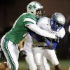 David Love (89) of Bishop McGuinness tackles Guthrie\'s J.T. McFadden (25) during a high school football game between Bishop McGuinness and Guthrie at Bishop McGuinness Catholic High School in Oklahoma City, Friday, Oct. 26, 2012. Photo by Nate Billings, The Oklahoman