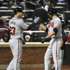 Atlanta Braves\' Chris Johnson (23) congratulates teammate Mike Minor at home plate after Minor hit a two-run home run off New York Mets starting pitcher Dillon Gee in the fifth inning of the second baseball game at Citi Field on Saturday, May 25, 2013, in New York. (AP Photo/Kathy Kmonicek)