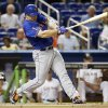 Photo - New York Mets' David Wright hits an RBI single to score Juan Lagares in the first inning of a baseball game against the Miami Marlins, Tuesday, Sept. 2, 2014, in Miami. (AP Photo/Lynne Sladky)