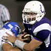 Bridge Creek\'s Cory Tallent (left) tries to get a hold of Bethany\'s quarterback J.P. Grasmick during their game at Bethany on Friday, Oct. 5 2007. By John Clanton, The Oklahoman