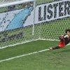 Photo - Mexico's goalkeeper Guillermo Ochoa fails to save a shot by Netherlands' Klaas-Jan Huntelaar from the penalty spot during the World Cup round of 16 soccer match between the Netherlands and Mexico at the Arena Castelao in Fortaleza, Brazil, Sunday, June 29, 2014. Holland won 2-1 and advanced to the quarterfinal.  (AP Photo/Themba Hadebe)