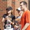 Shelly Budke, left, talks with Doug Gottlieb after the Remember the Ten run was in Stillwater, Okla on April 21, 2012. Photo by Mitchell Alcala, for the Oklahoman
