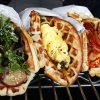 Photo - Waffle Champion, a mobile kitchen, serves sweet and savory waffles made to order. Photo By David McDaniel/The Oklahoman