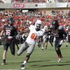 Oklahoma State\'s Justin Blackmon (81) scores a touchdown as he is chased by Texas Tech\'s Cody Davis (16) and Happiness Osunde (28) during a college football game between Texas Tech University (TTU) and Oklahoma State University (OSU) at Jones AT&T Stadium in Lubbock, Texas, Saturday, Nov. 12, 2011. Photo by Sarah Phipps, The Oklahoman ORG XMIT: KOD