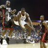 Oklahoma City\'s Jeff Green loses control of the ball after a foul between Miami\'s Joel Anthony, left, and Mario Chalmers during a preseason NBA basketball game between the Oklahoma City Thunder and the Miami Heat at the BOK Center in Tulsa, Okla., Wednesday, October 14, 2009. Photo by Bryan Terry, The Oklahoman ORG XMIT: KOD